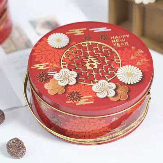 hộp thiếc tròn màu đỏ họa tiết hoa trắng